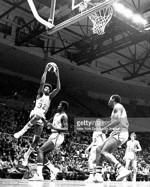 Y Nets Julius Erving pops a jumper against the TAMs at the Nassau Coliseum yesterday afternoon