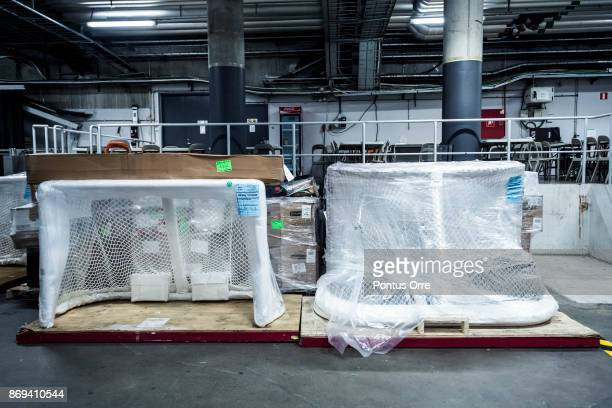 NHL nets wrapped in plastic are seen in Ericsson Globe during the rink build out ahead of the SAP NHL Global Series between Ottawa Senators and...