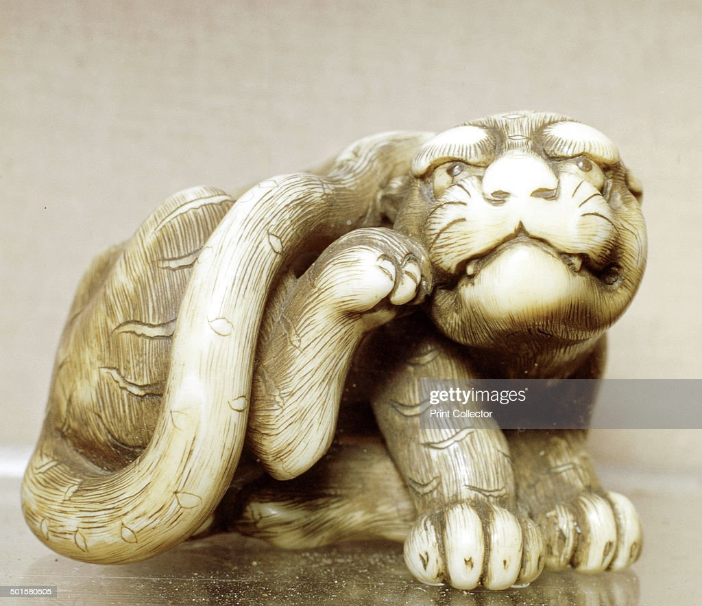 Netsuke carved in the form of a rat, one of the 12 animals of the