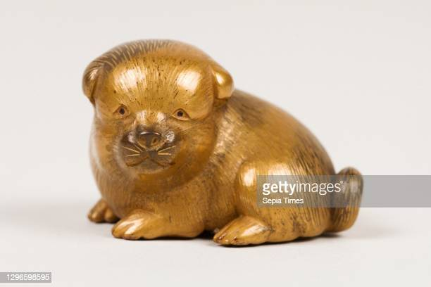 Netsuke of Seated Puppy with Short Curled Tail, first half of the 19th century, Japan, Wood, gold lacquer mottled with black; black lacquer eyes, H....