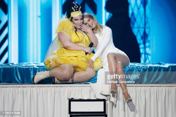 Netta Barzilai and Bar Refaeli on stage during the 64th annual Eurovision Song Contest held at Tel Aviv Fairgrounds on May 18 2019 in Tel Aviv Israel