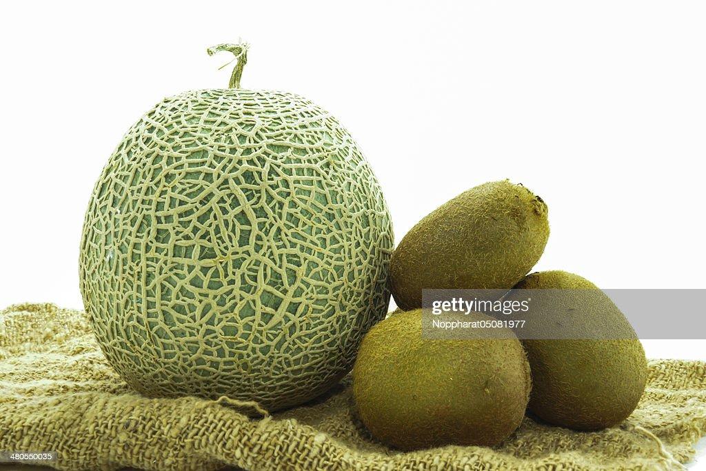 Netted melon and kiwi on white background : Stock Photo