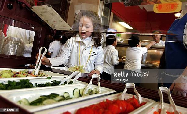 Nettelhorst Elementary School student Alexia Kollar selects food from a salad bar during lunch March 20 2006 in Chicago Illinois US Senator Dick...