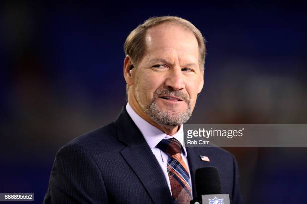 Network analyst Bill Cowher appears on set during the Baltimore Ravens and Miami Dolphins game at MT Bank Stadium on October 26 2017 in Baltimore...