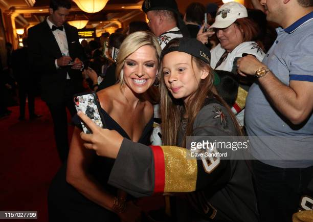 Network analyst Kathryn Tappen poses for a photo with Vegas Golden Knights fan Logan Sokoloski at the 2019 NHL Awards on June 19, 2019 in Las Vegas,...