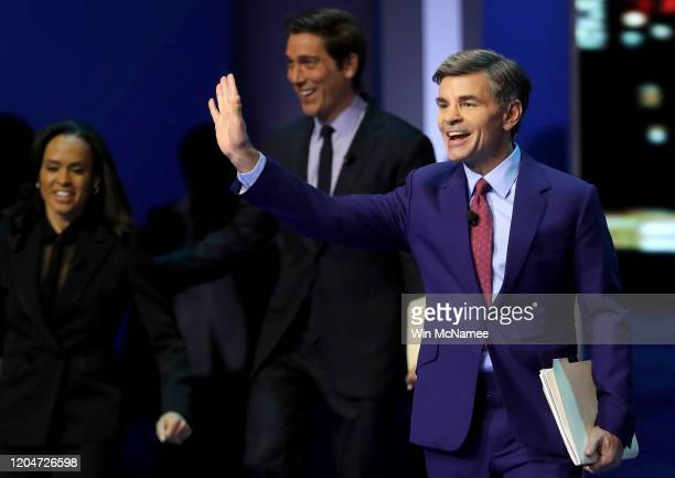 Network anchors and debate moderators David Muir, Linsey Davis and George Stephanopoulos arrive on stage prior to the Democratic presidential primary...