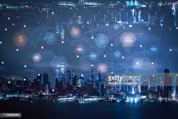 network and technology connection concept with city background - building icon stock photos and pictures
