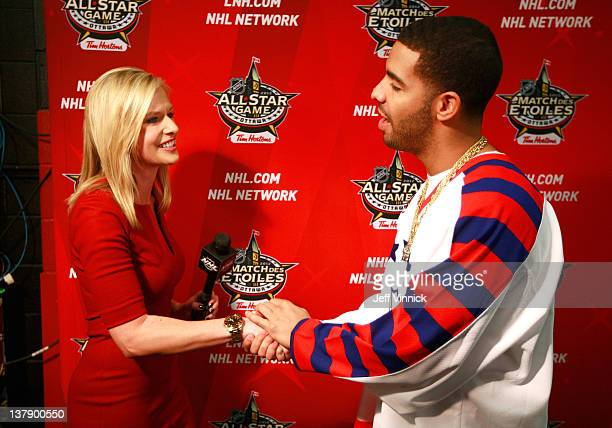 Network broadcaster Kathryn Tappen greets musical artist Drake during the first intermission of the 2012 Tim Hortons NHL AllStar Game at Scotiabank...