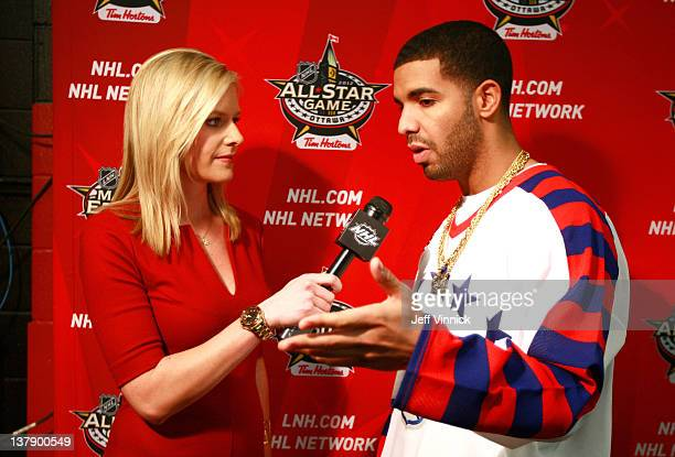 Network broadcaster Kathryn Tappen interviews musical rap artist Drake during the first intermission of the 2012 Tim Hortons NHL AllStar Game at...