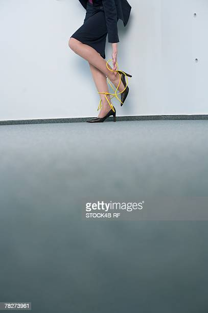 network cable wrapped around businesswoman's legs - bound in high heels stock photos and pictures