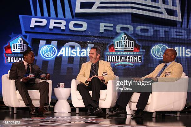 NFL Network Commentator Fran Charles speaks with Pro Football Hall of Famers Dan Fouts and Warren Moon during the Pro Football Hall of Fame News...