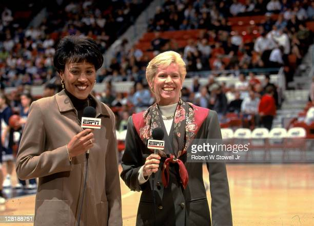 Network commentators Mimi Griffin, left, and Robin Roberts, right, do a pre-game report from the court, prior to a University of Connecticut women's...