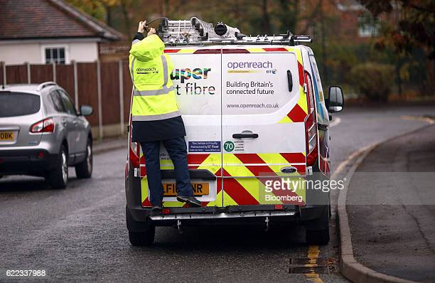 A network engineer from Openreach a unit of BT Group Plc secures a ladder not to the top of a van outside a residential property in this arranged...
