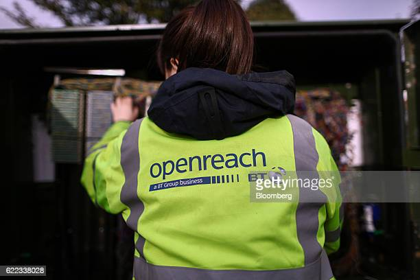 A network engineer from Openreach a unit of BT Group Plc works on wiring inside a primary connection point box in this arranged photograph in...