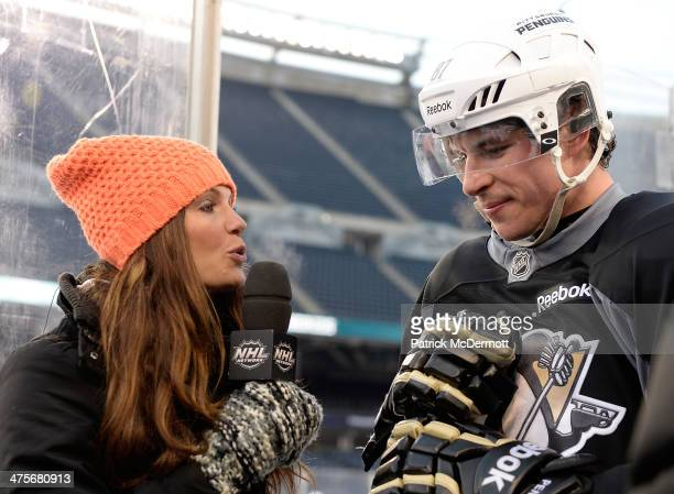 NHL Network host Heidi Androl interviews Sidney Crosby of the Pittsburgh Penguins during the 2014 NHL Stadium Series practice day on February 28 2014...
