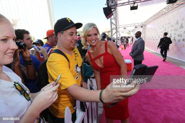 Network host Kathryn Tappen poses for a selfie photo as she arrives on the magenta carpet for the 2017 NHL Awards at T-Mobile Arena on June 21, 2017...