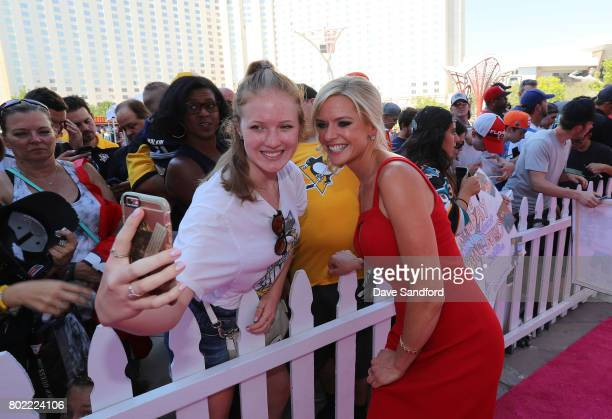 Network host Kathryn Tappen poses for a selfie photo as she arrives on the magenta carpet for the 2017 NHL Awards at TMobile Arena on June 21 2017 in...