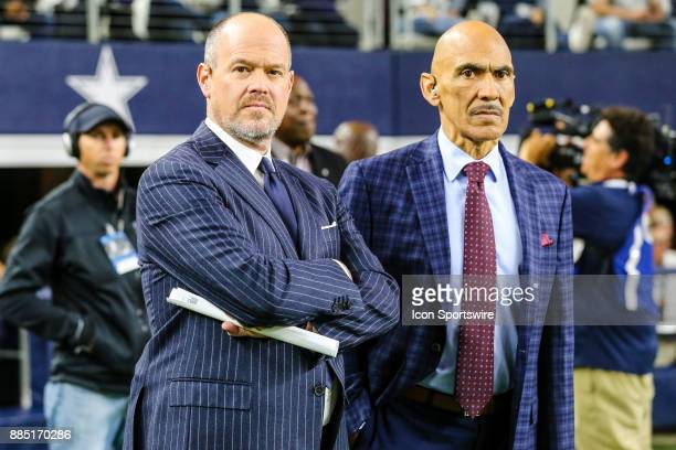 Network host Rich Eisen and NBC analyst Tony Dungy watch from the sidelines during the game between the Dallas Cowboys and the Washington Redskins on...