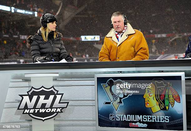 NHL Network hosts Kathryn Tappen and Barry Melrose look on during the 2014 NHL Stadium Series game at Soldier Field on March 1 2014 in Chicago...