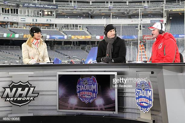 NHL Network hosts Kathryn Tappen Mike Johnson and Peter DeBoer of the New Jersey Devils speak on set during the 2014 NHL Stadium Series practice...