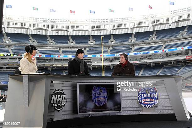 NHL Network hosts Kathryn Tappen Mike Johnson and Peter Laviolette on set during the 2014 NHL Stadium Series practice sessions and family skate for...