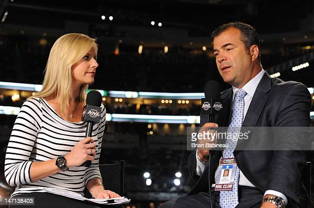 Network Kathryn Tappan listens as Head coach Alain Vigneault of the Vancouver Canucks provides commentsary during Rounds 27 of the 2012 NHL Entry...