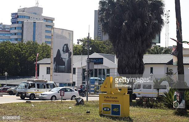 A 4G network logo sits on an MTN Group Ltd advertisement in Accra Ghana on Monday Sept 19 2016 Ghana's central bank expects mergers and acquisitions...