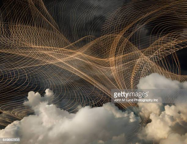 Network of light streams in cloudy sky
