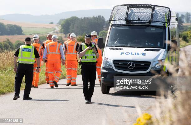 Network Rail engineers and Police officers work near the scene of a train crash by Stonehaven in northeast Scotland on August 12, 2020. - A passenger...