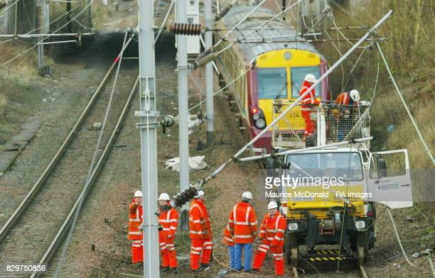 Network Rail workers fixing downed power lines on the Glasgow to Greenock line