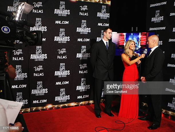 Network reporter Michelle Beisner interviews former NHL player Mark Messier as Zdeno Chara of the Boston Bruins looks on during the 2011 NHL Awards...
