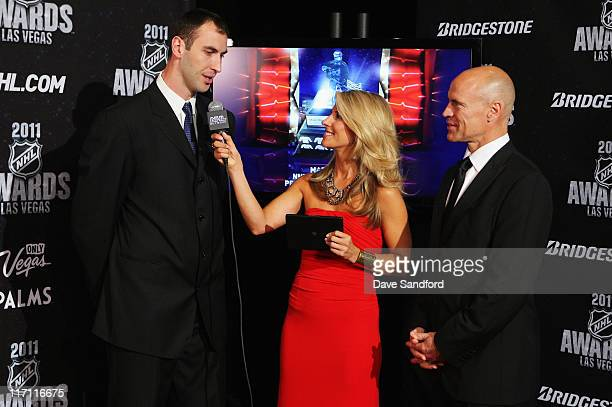 Network reporter Michelle Beisner interviews Zdeno Chara of the Boston Bruins as former NHL player Mark Messier looks on during the 2011 NHL Awards...