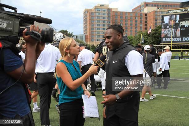Network sideline reporter Dawn Davenport interviews Vanderbilt Commodores head coach Derek Mason following the Vanderbilt Commodores game against the...