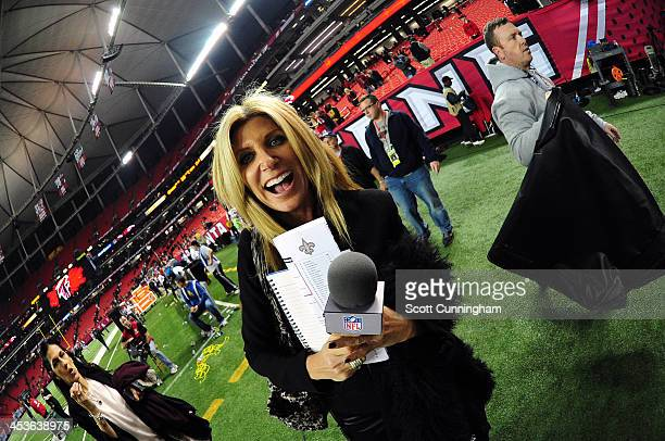 Network sideline reporter Laura Okmin heads off the field after the game between the Atlanta Falcons and the New Orleans Saints at the Georgia Dome...
