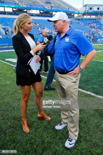 Network Sideline Reporter Olivia Harlan Interviews Head Coach Mark Stoops Of The Kentucky Wildcats After The