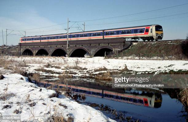 Network Southeast liveried Class 321 EMU on a Birmingham to Euston service between Rugby and Northampton.