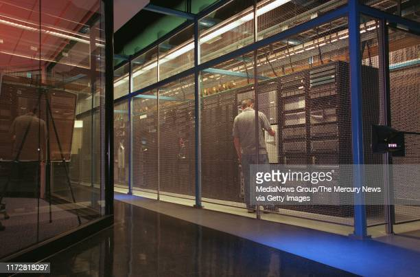 NEWS 3/5/01 Network Specialist Charles Sansoni works on an Equinix server inside the main data storage facility at Equinix in South San Jose Inside...