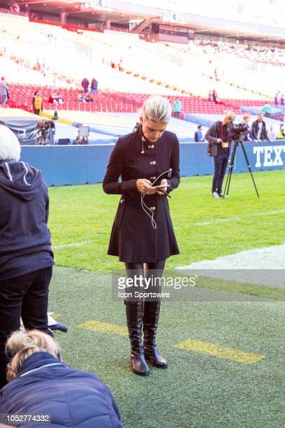 Network Sportscaster Melissa Stark checks her phone before the NFL game between the Tennessee Titans and the Los Angeles Chargers on October 21 2018...