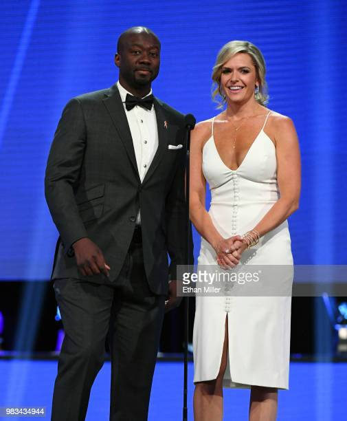 Network sportscasters Anson Carter and Kathryn Tappen speak during the 2018 NHL Awards presented by Hulu at The Joint inside the Hard Rock Hotel...