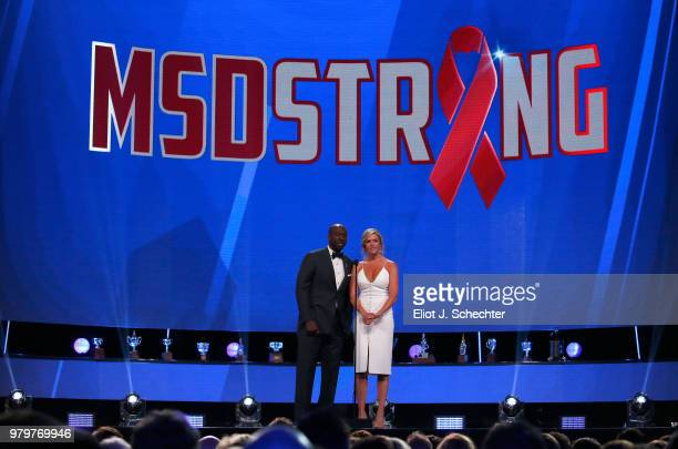 Network sportscasters Anson Carter and Kathryn Tappen speak onstage prior to announcing the winner of the Calder Memorial Trophy during the 2018 NHL...