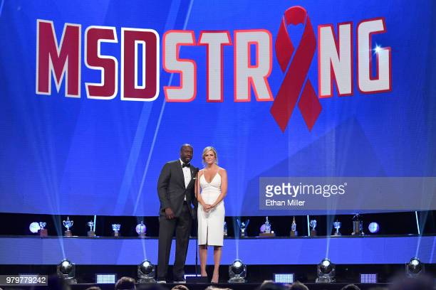Network sportscasters Anson Carter and Kathryn Tappen speak onstage prior to announcing the winner of the Calder Memorial Trophy at the 2018 NHL...