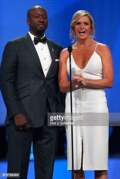 Network sportscasters Kathryn Tappen and Anson Carter speak onstage prior to announcing the winner of the Calder Memorial Trophy during the 2018 NHL...
