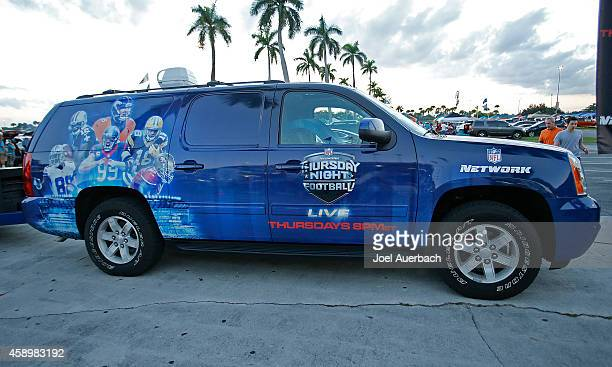 'NFL' Network vn parked outside Sun Life Stadium displaying their Thursday night Football logo prior to the game between the Miami Dolphins and the...