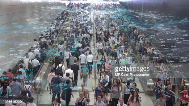 networking connection and communication concept with crowd commuters of pedestrian commuters on train station at hong kong station.internet of things and big data concept - blockchain foto e immagini stock