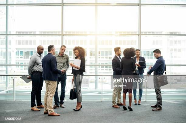networking with fellow attendees - attending stock pictures, royalty-free photos & images
