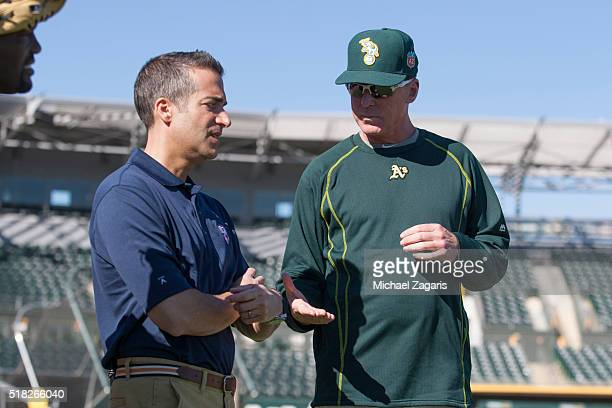 Network's Matt Vasgersian talks with Manager Bob Melvin of the Oakland Athletics in the field prior to a spring training game between the Athletics...