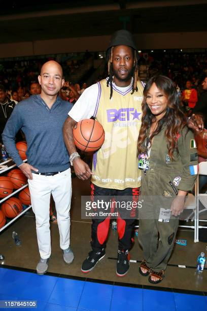 Networks President Scott M Mills 2 Chainz EVP Head of Programming BET Networks Connie Orlando attends in the BETX Celebrity Basketball Game Sponsored...