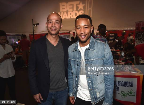 Networks President Scott M Mills and John Legend attend day one of the 2018 BET Awards Radio Remotes on June 22 2018 in Los Angeles California
