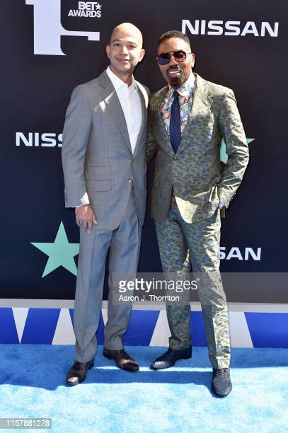 BET Networks President Scott M Mills and President Media Sales at BET Louis Carr attend the 2019 BET Awards on June 23 2019 in Los Angeles California