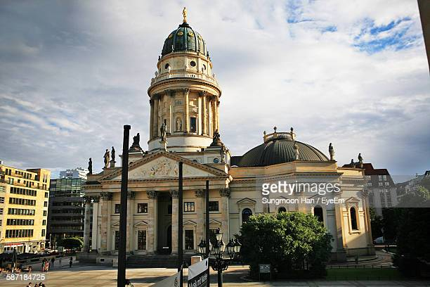 neue kirche against cloudy sky - kirche stock pictures, royalty-free photos & images